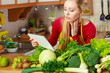 Woman having green vegetables thinking about cooking - 176665942