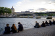 People having fun at the Seine River walkaway, Paris, France