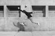 Asian guy midair jumpshot outdoors