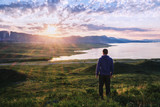 Man meets the dawn/The man from the back looks at the lake, the mountains and the sunrise, Bukhtarma Reservoir, Eastern Kazakhstan - 176684173