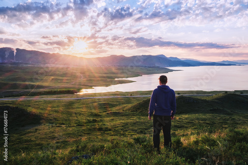 Man meets the dawn/The man from the back looks at the lake, the mountains and the sunrise, Bukhtarma Reservoir, Eastern Kazakhstan
