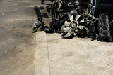 the stack of old machine on cement ground  in the garage - 176687320