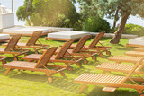 Hotel Poolside Chairs on a green meadow - 176688355
