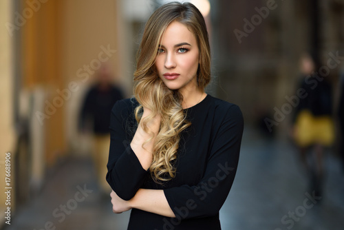 Beautiful blonde russian woman in urban background - 176688906