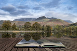 Stuning Autumn Fall landscape image of Lake Buttermere in Lake District England concept coming out of pages in open book - 176689185
