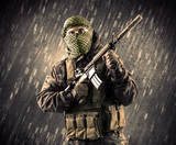 Armed terrorist man with mask on rainy background - 176689583