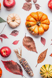 Autumn flat lay composing with pumpkin, apples and fall leaves , top view - 176692980
