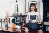 Asian female barista wear jean apron crossed her arms at counter bar with smile face,cafe service concept,owner business start up. - 176694184