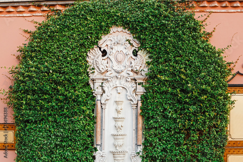 White marble sculpture surrounded by greenery in Sultan Ahmet square Poster