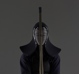 male in tradition kendo armor with shinai (bamboo sword).