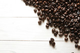 roasted coffee beans background on wood - 176720138