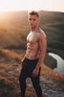 Shirtless muscular man on hill