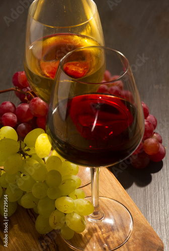 Red and wite wine in glasses with fresh grape