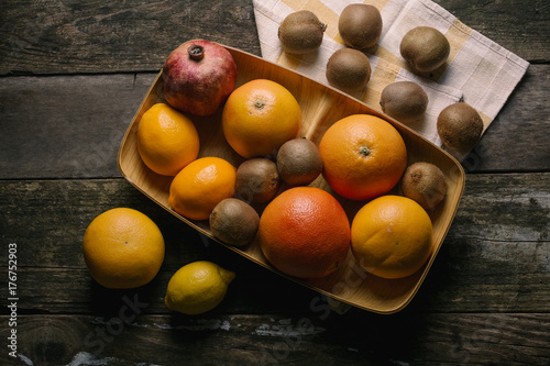 Fresh fruits ready for juice on a wooden table