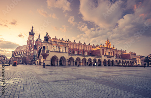 Fotobehang Krakau St Mary's church and cloth hall on Main Market Square in Krakow, colorful morning