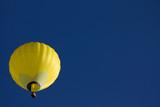 Yellow hot air ballon on blue sky. - 176761940
