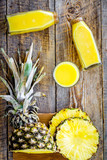 Freshly squeezed pineapple juice near fruit slices on wooden background top view - 176769922