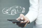 Businessman hand phone with  car - 176770565