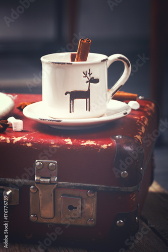 Fotobehang Chocolade Hot Chocolate with Marshmellow candies. Warming holiday drink with cinnamon sticks . Warm Christmas.Winter Still Life in the Cup.Toned image Vintage style