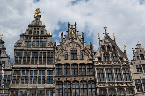 Plexiglas Antwerpen Vernacular Belgian architecture with Dutch stepped gables surrounding the Grote Markt in Antwerp, Belgium on a cloudy summer day.