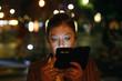 Woman looking smartphone
