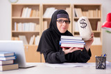 Muslim girl in hijab studying preparing for exams - 176786723
