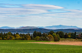 landscape of countryside on Grand Isle, one of the Lake Champlain Islands with Green Mountains of Vermont across the lake