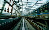 Train moving on city rail with motion blur - 176792395