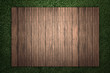 Wood with green grass background - 176794908