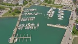 aerial overview of colourful harbour stocked with boats 4k - 176797786