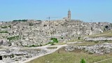 panoramic view of typical stones Sassi di Matera and church of Matera under blue sky. Basilicata, Italy, zoom out camera movement - 176803971