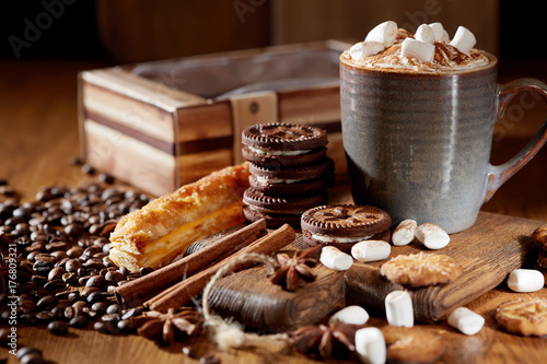 Aroma coffee candy chocolate cookies and spices on the wooden table. Christmas sweets. Dark wooden background. Close. Closeup.
