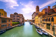 Venice canal in Cannaregio and San Geremia church landmark. Italy