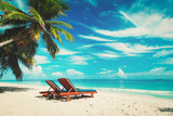 Two beach chairs on tropical vacation - 176825929