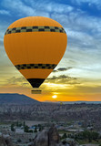 Hot air balloon flying over rock landscape - 176826159