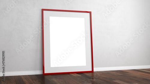 Leerer roter Bilderrahmen an Wand