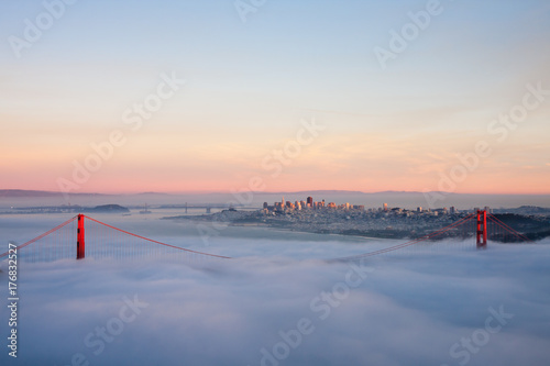 Golden gate bridge from the top view during sunset time over the sea of fog Poster
