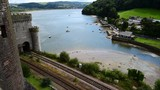 View from Conwy castle looking down on the estuary and railway. - 176836775