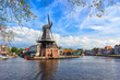 Picturesque landscape with a windmill of the Dutch city of Haarlem. - 176837509