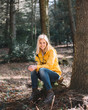 Quadro Young woman relaxing in forest. Lifestyle concept.
