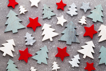 Christmas wooden decor on the snow background.
