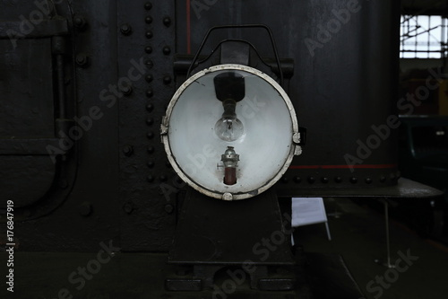 Detail of the steam engine lamp with bulb and burner Poster