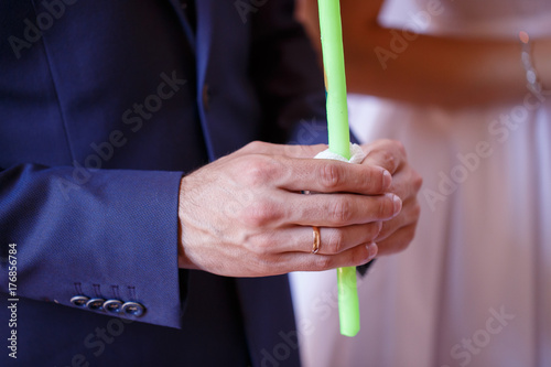 Wedding couple holding candles at the wedding ceremony in the Christian church Poster