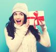 Quadro Young woman holding a Christmas gift box