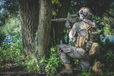 Airsoft soldier in the woods - 176865174