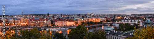 Staande foto Praag Prague, Czech Republic - October 10, 2017: Beautiful evening panorama of Prague city center, view on Intercontinental hotel, bridges across Vltava river, TV Tower, Tyn Church of Prague, Czech Republic