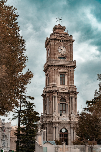 Clock tower of Dolmabahce Palace in Istanbul, Turkey in autumn Poster