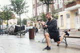 A man working out on a street - 176867776