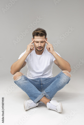Plakat Thinking handsome man sitting