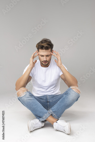 Thinking handsome man sitting